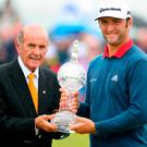 Spain's Jon Rahm with the trophy after winning the Dubai Duty Free Irish Open at Portstewart