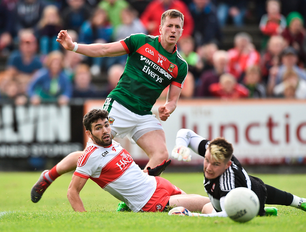 Cillian O'Connor of Mayo has his shot saved by Derry goalkeeper Ben McKinless