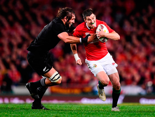 Johnny Sexton of the Lions is hauled down by Sam Whitelock. 'We could have won it. I knew we had a great chance before the game,' said the Lions No 10. Photo by Stephen McCarthy/Sportsfile