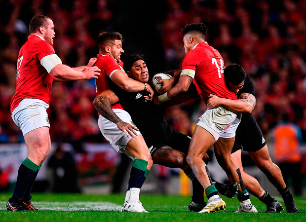Malakai Fekitoa of New Zealand is tackled by British and Irish Lions players, from left, Jack McGrath, Rhys Webb and Anthony Watson. Photo by Stephen McCarthy/Sportsfile