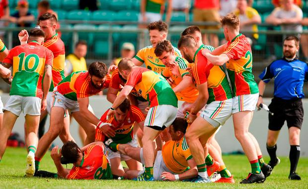 Carlow and Leitrim players get involved in a tussle. Photo: Barry Cregg/Sportsfile