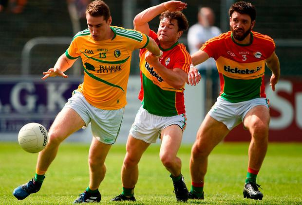 Keith Beirne feels the pressure from Carlow's Kieran Nolan, centre, and Sahne Redmond. Photo: Barry Cregg/Sportsfile