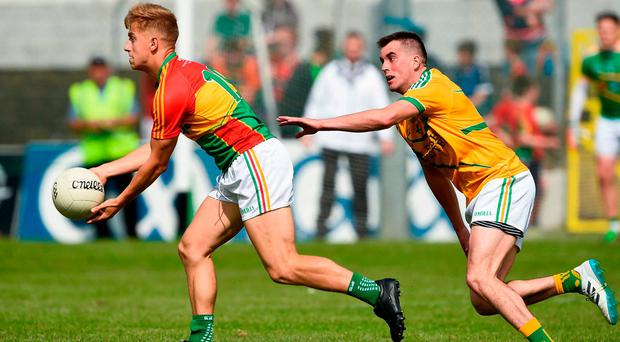 Darragh O'Brien looks for a pass under pressure from Leitrim's Paddy Maguire. Photo: Barry Cregg/Sportsfile