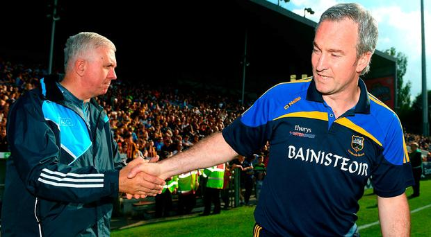 Dublin manager Ger Cunningham (left) shakes hands with his opposite number Michael Ryan as Tipperary marched into the quarter-finals. Photo: RAY MCMANUS/SPORTSFILE