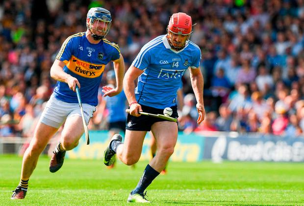 Ryan O'Dwyer is chased down by Tipperary's Tomás Hamill. Photo: Ray McManus/Sportsfile