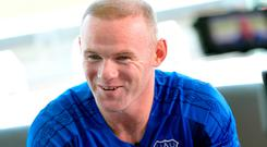 A delighted Wayne Rooney back in the Everton blue yesterday. Photo: Getty Images