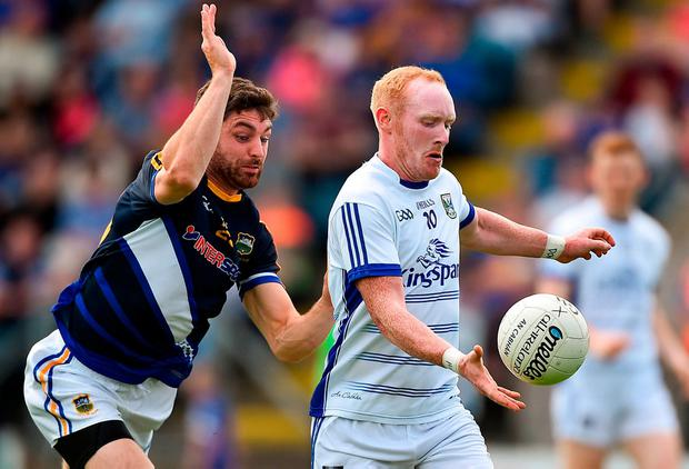 Cian Mackey under pressure from Tipperary's Philip Austin. Photo: David Maher/Sportsfile