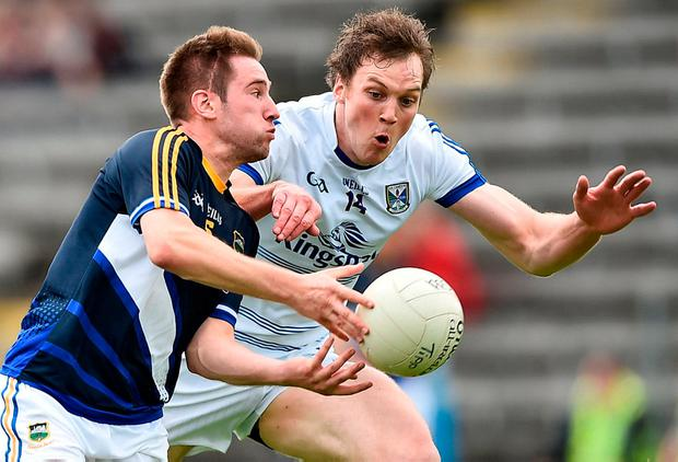 Tipperary's Bill Maher is tackled by Gearoid McKiernan. Photo: David Maher/Sportsfile