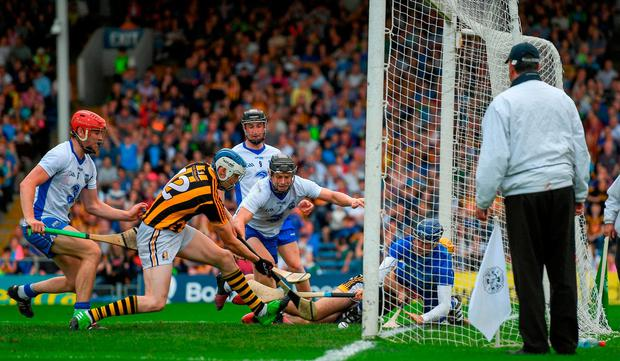 T J Reid, scrambles the sliothar past Waterford goalkeeper Stephen O'Keeffe. Photo: Ray McManus/Sportsfile