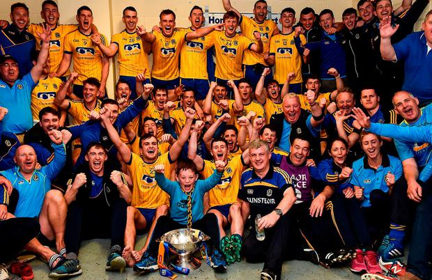 Roscommon players and management celebrate with the Nestor Cup after victory over Galway in Salthill. Photo: DAVID MAHER/SPORTSFILE