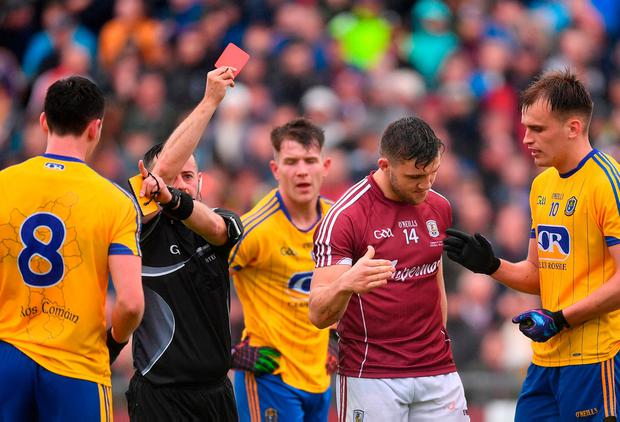 Damien Comer is shown a red card by referee David Gough. Photo: Ramsey Cardy/Sportsfile