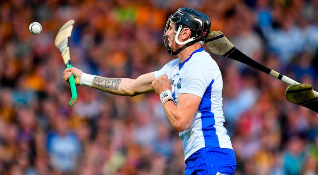 Maurice Shanahan shoots to score Waterford's fourth goal with this onehanded effort during extra time of their All-Ireland SHC qualifier in Thurles. Photo: BRENDAN MORAN/SPORTSFILE