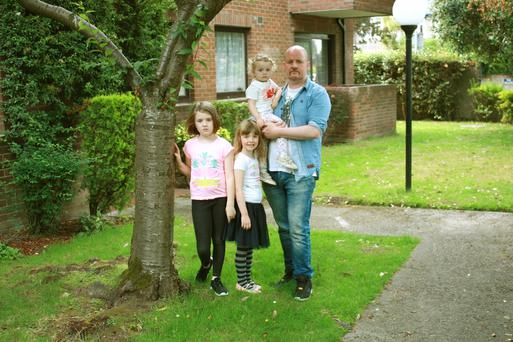 Ronnie Byrne from Dublin with his daughters Niamh (8), Orlaith (5) and Aoife (2)