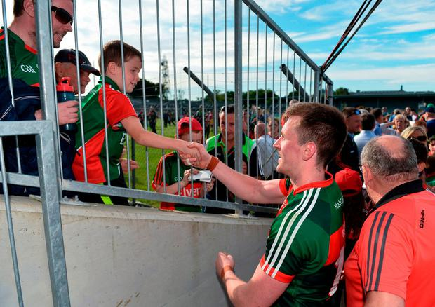 Mayo's Cillian O'Connor exchanges a handshake with Jake Hyland, aged 7, from Tubbercurry, Co. Mayo, after their Championship win over Clare in Ennis. Photo: Diarmuid Greene/Sportsfile
