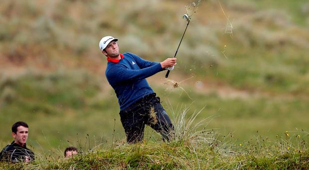 Spain's Jon Rahm plays from the rough at Portstewart on his way to victory at the Dubai Duty Free Irish Open Golf. Photo: Reuters/Paul Childs