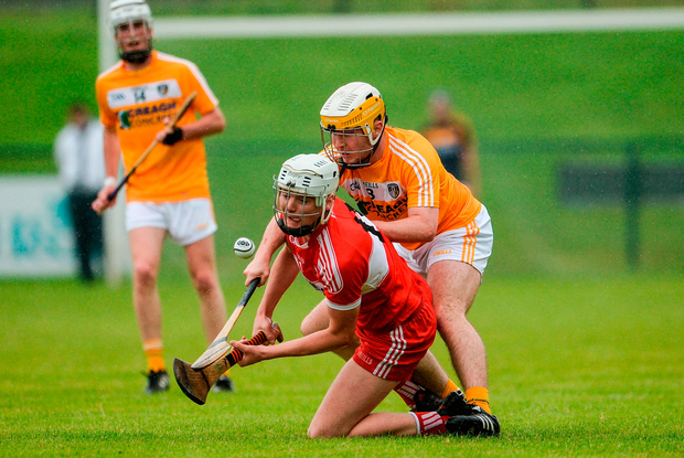 Eoghan O'Kane of Derry in action against Michael McGreevy of Antrim. Photo by Oliver McVeigh/Sportsfile