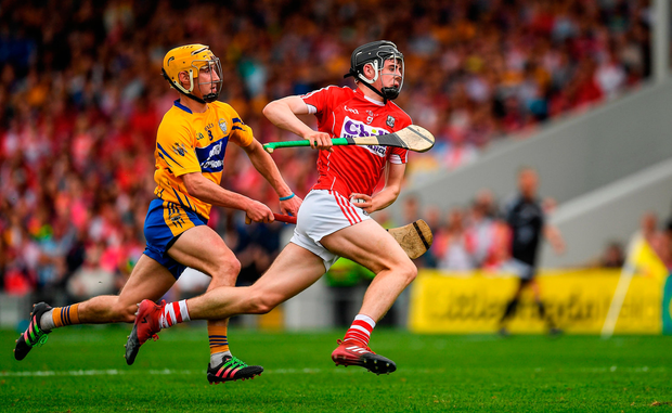 Darragh Fitzgibbon of Cork in action against Colm Galvin of Clare. Photo by Ray McManus/Sportsfile
