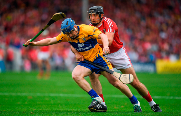 Podge Collins of Clare is tackled by Christopher Joyce of Cork. Photo by Brendan Moran/Sportsfile