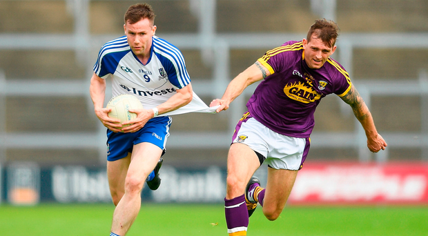 Monaghan's Owen Duffy in action against Adrian Flynn of Wexford. Photo by Eóin Noonan/Sportsfile