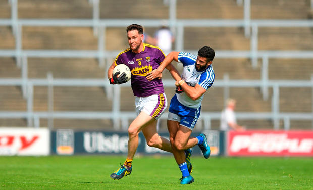 Daithi Waters of Wexford in action against Neil McAdam of Monaghan. Photo by Eóin Noonan/Sportsfile