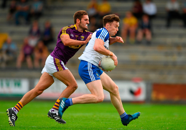 Fintan Kelly of Monaghan in action against Brian Malone of Wexford. Photo by Eóin Noonan/Sportsfile