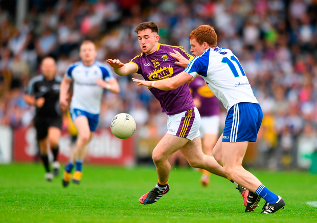 John Tubritt of Wexford in action against Kieran Duffy of Monaghan. Photo by Eóin Noonan/Sportsfile