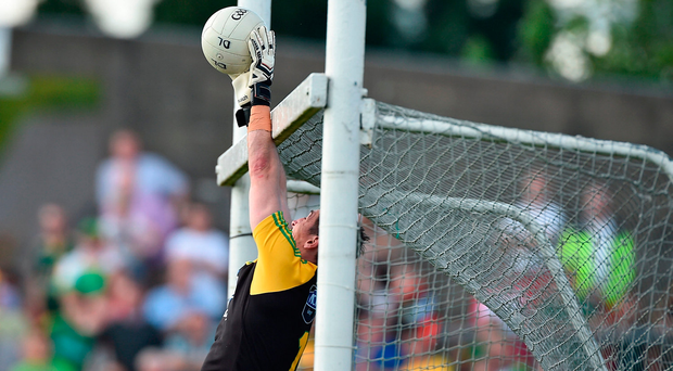 Donegal goalkeeper Mark Anthony McGinley prevents a score going over the bar. Photo by David Maher/Sportsfile
