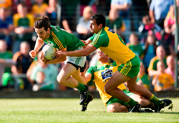 Cillian O'Sullivan of Meath in action against of Frank McGlynn of Donegal. Photo by David Maher/Sportsfile