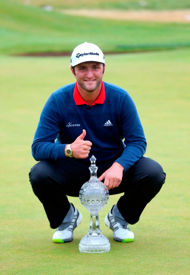 Jon Rahm with the trophy