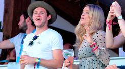 Niall Horan and Laura Whitmore sing along with Tom Petty as they attend the Barclaycard Exclusive British Summer Time Festival at Hyde Park on July 9, 2017 in London, England. (Photo by Eamonn M. McCormack/Getty Images for Barclaycard)
