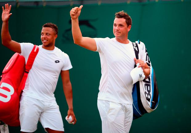 Marcus Willis and Jay Clarke celebrate their doubles win over Pierre-Hugues Herbert and Nicolas Mahut on day six of the Wimbledon Championships at The All England Lawn Tennis and Croquet Club, Wimbledon