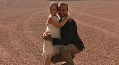 Harper Beckham with dad David at Buckingham Palace. Picture: Instagram