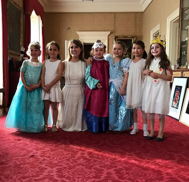 Harper Beckham with pals at a tea party in Buckingham Palace. Picture: Instagram