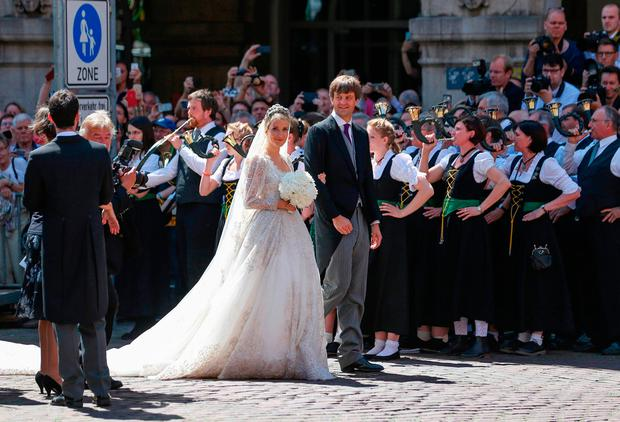 Ekaterina of Hanover and Prince Ernst August of Hanover leave after their church wedding ceremony in Hanover, central Germany, on July 8, 2017