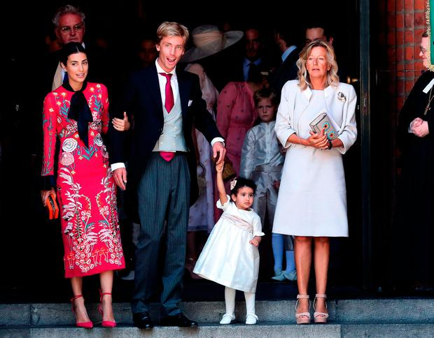 Prince Christian (2nd L) of Hanover, his wife Alessandra de Osma (L) and Chantal Hochuli (R) leave after the church wedding of Prince Ernst August of Hanover and Ekaterina of Hanover in Hanover, central Germany, on July 8, 2017
