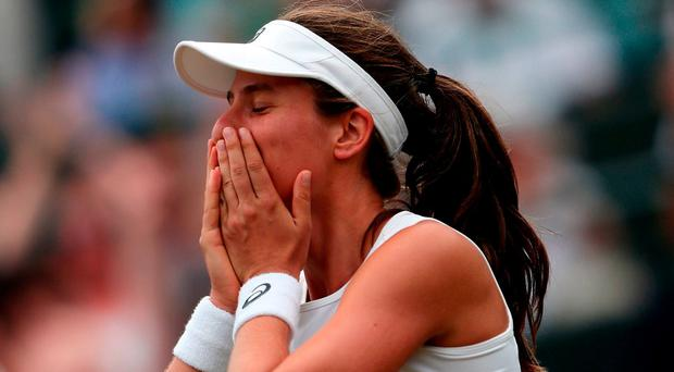 Johanna Konta celebrates victory over Caroline Garcia on day seven of the Wimbledon Championships at The All England Lawn Tennis and Croquet Club, Wimbledon.
