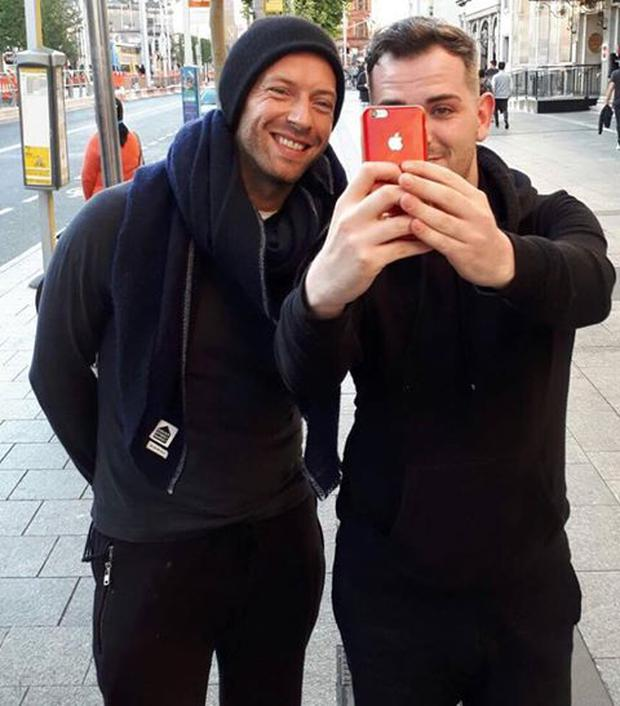 Jamie Kelly pictured with Coldplay's Chris Martin