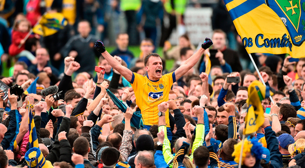Enda Smith celebrates with Roscommon supporters. Photo by David Maher/Sportsfile