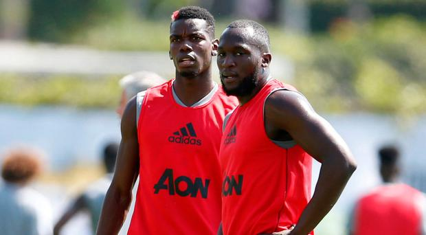 Paul Pogba and Romelu Lukaku take a breather during training in Los Angeles yesterday. Photo: Reuters/Lucy Nicholson