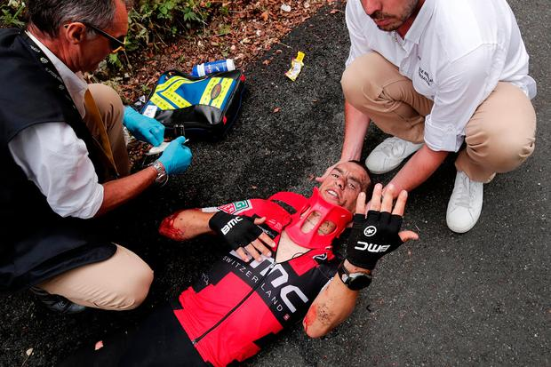 Richie Porte of Australia receives help after his crash. Photo: Reuters/Benoit Tessier