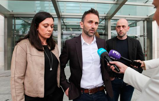 David Sweeney pictured leaving Dublin Central Criminal Court with family and friends following the sentencing of Gary Walsh. Photo: Collins Courts