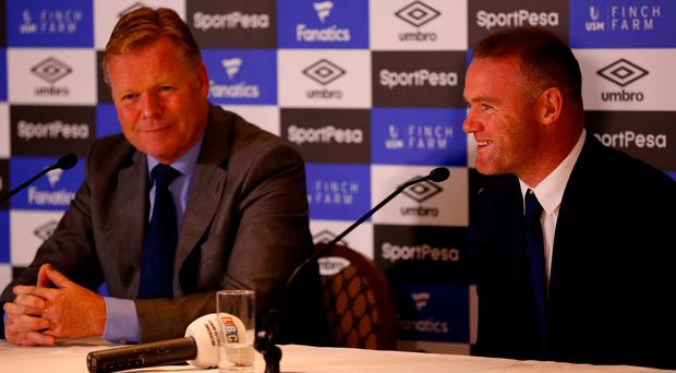 Wayne Rooney had plenty to smile about at yesterday's press conference alongside Everton boss Ronald Koeman. Photo: Phil Noble/Reuters