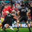 Kyle Sinckler of the British & Irish Lions is tackled by Charlie Faumuina of New Zealand