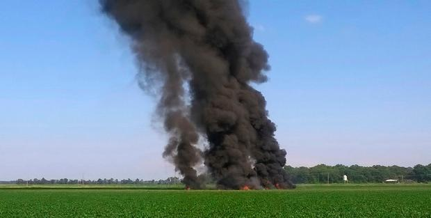 In this photo provided by Jimmy Taylor, smoke and flames come from the wreckage after a military transport airplane crashed in a field near Itta Bena, Miss., on the western edge of Leflore County, Monday, July 10, 2017, killing several. (Jimmy Taylor via AP)