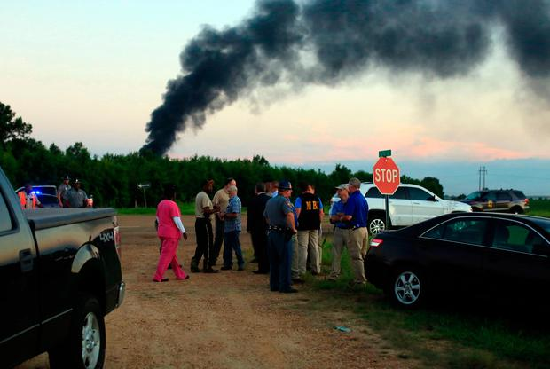 Emergency officials respond to the site of a military plane crash near Itta Bena, Miss., Monday, July 10, 2017. (Elijah Baylis/The Clarion-Ledger via AP)