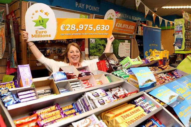 Shop staff celebrate selling the 29m Euromillions winning ticket at Garryduff Stores, Pound Road, Castlebar (Photo: Keith Heneghan)