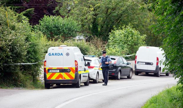 Gardai at the scene of a fire in Tully East, Kildare where two men died this morning. Photo: Tony Gavin