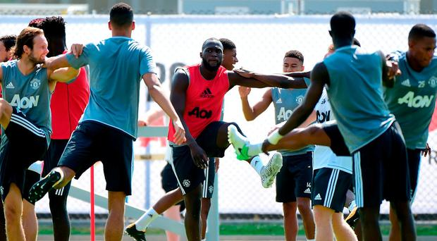 Romelo Lukaku of Manchester United stretches with teammates during training for Tour 2017 at UCLA's Drake Stadium yesterday