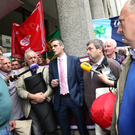 IFA President Joe Healy addresses IFA members outside the Department of Agriculture.