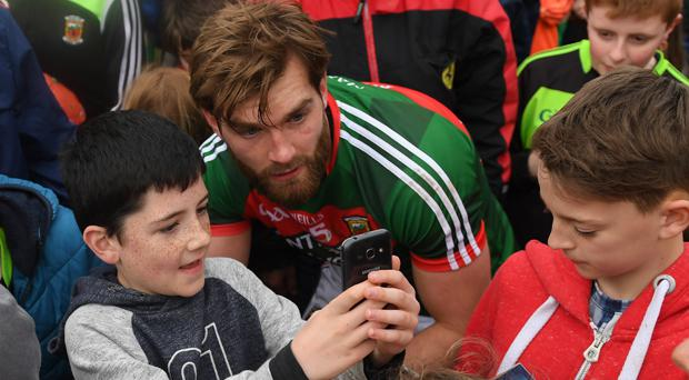 Aidan O'Shea poses for a young Mayo after a league game earlier this year